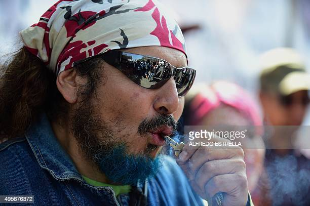 A man smokes marijuana during a rally in front of the Supreme Court of Justice in Mexico City on November 4 2015 Mexico's Supreme Court opened the...