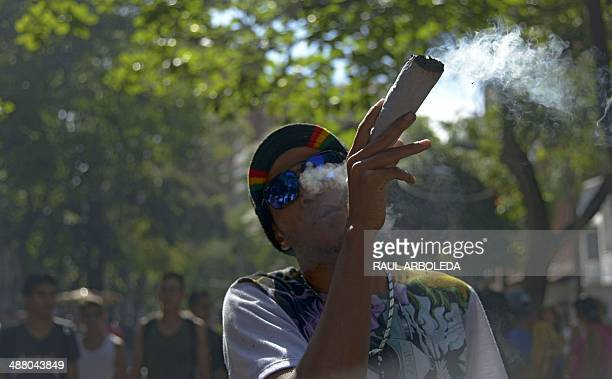 A man smokes marijuana during the World Day for the Legalization of Marijuana in Medellin Antioquia department Colombia on May 3 2014 AFP PHOTO/Raul...