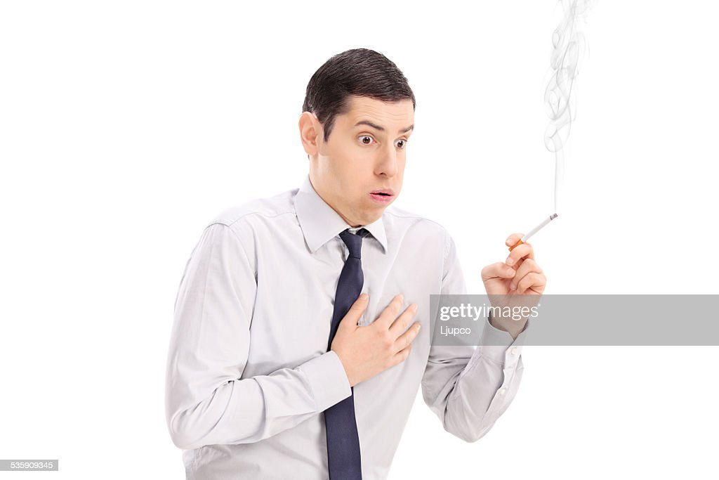 Man smoking a cigarette and feeling chest pain : Stock Photo