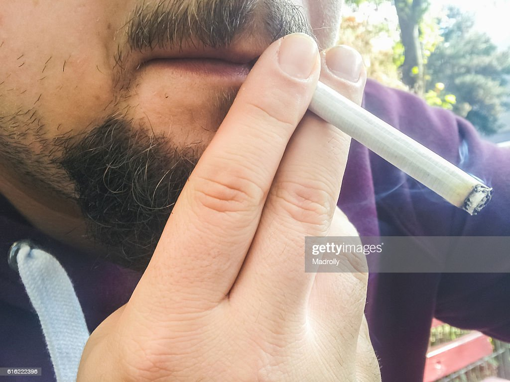 Man smoking. Closeup to mouth : Stock Photo