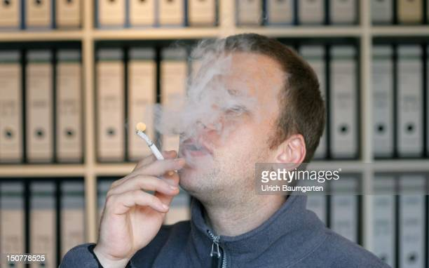 Man smoking in the office