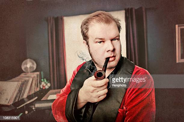 Man smoking pipe in his living room