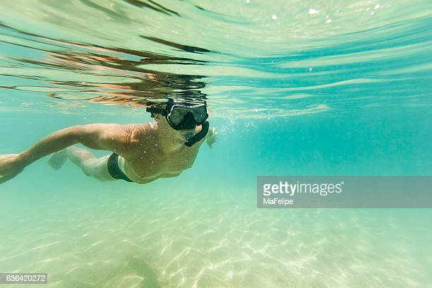 Man Snorkeling in Clear Turquoise Water