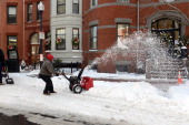 A man snow blows on East Concord Street in the South End after a two day winter storm January 4 2014 in Boston Massachusetts The storm began mid day...