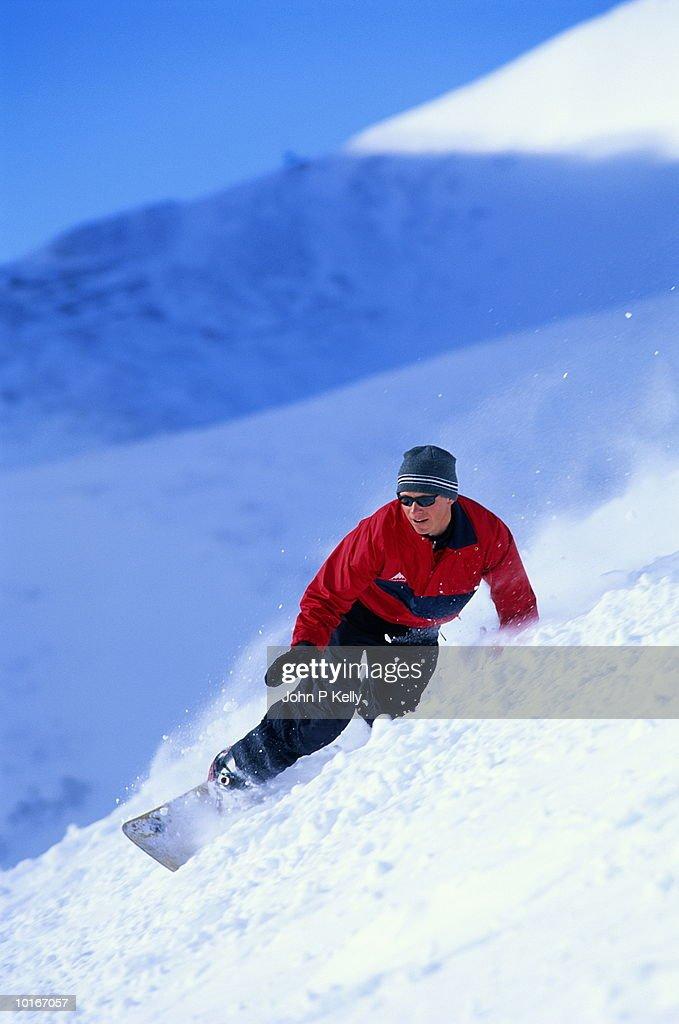 Man snowboarding, Snowmass, Colorado, USA : Stock Photo
