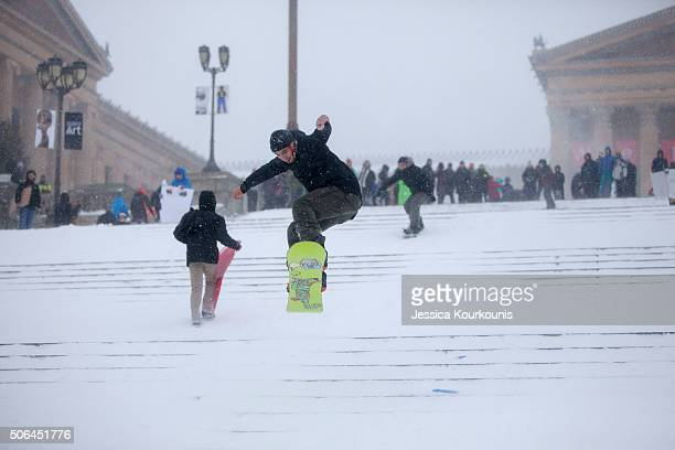 A man snowboards down the Philadelphia Art Museum steps as snow continues to fallon January 23 2016 in Philadelphia Pennsylvania The city which...
