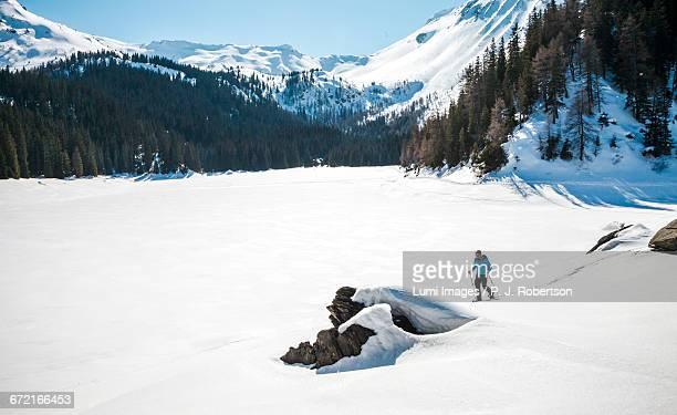 Man snowshoeing in Alpine winter landscape