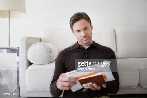 Man sorting bills at home : Stock Photo