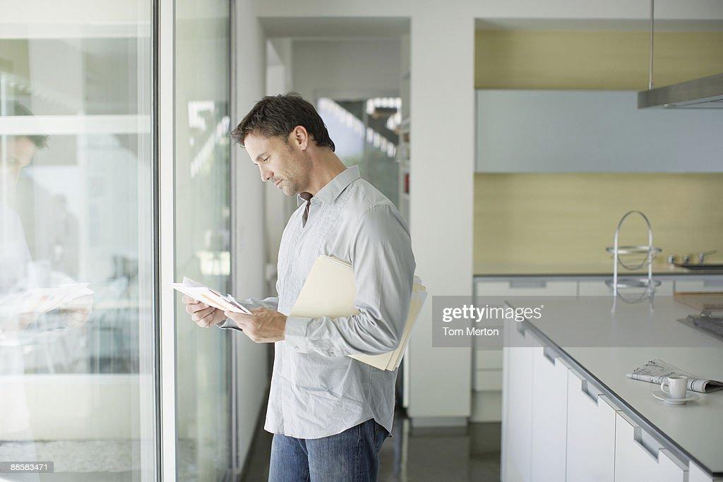 Man sorting mail at home