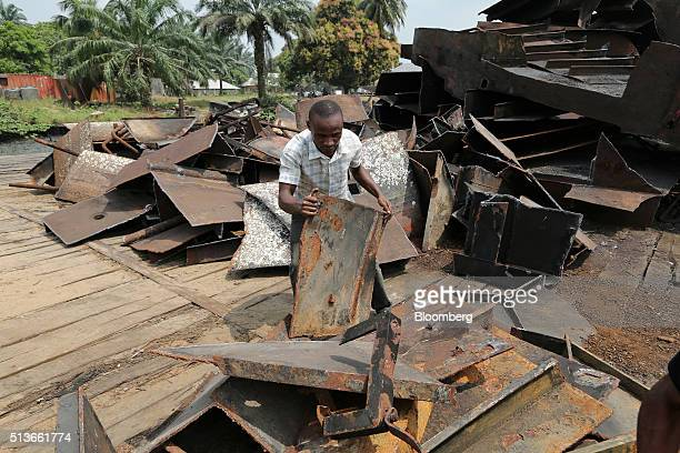 A man sorts metal scraps salvaged from local shipwrecks at a recycling yard in Bodo Nigeria Wednesday Jan 13 2016 Twenty years after the oilpollution...