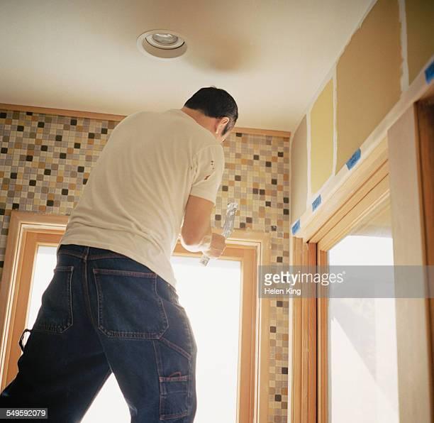 Man Spackling Tile