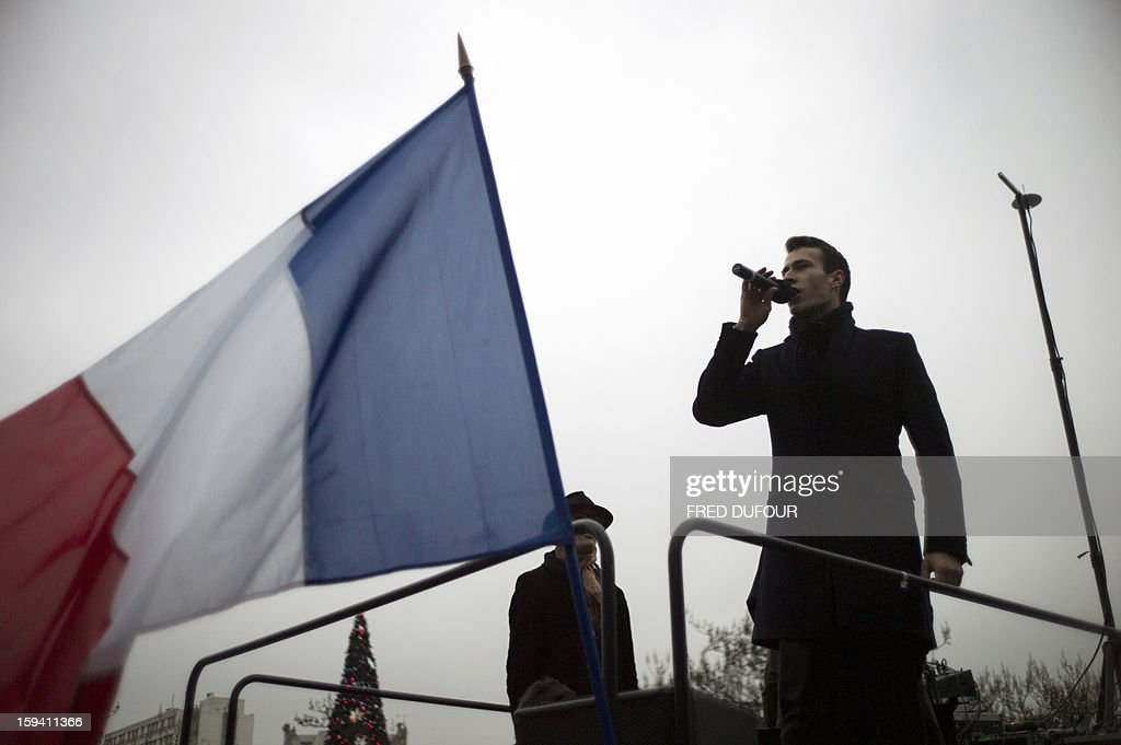 A man speaks in a microphone during a march against same-sex marriage on January 13, 2013 in Paris. Tens of thousands march in Paris on January 13 to denounce government plans to legalise same-sex marriage and adoption which have angered many Catholics and Muslims, France's two main faiths, as well as the right-wing opposition. The French parliament is to debate the bill -- one of the key electoral pledges of Socialist President -- at the end of this month. Banner on top reads : 'Two fathers, two mothers, child in disarray.