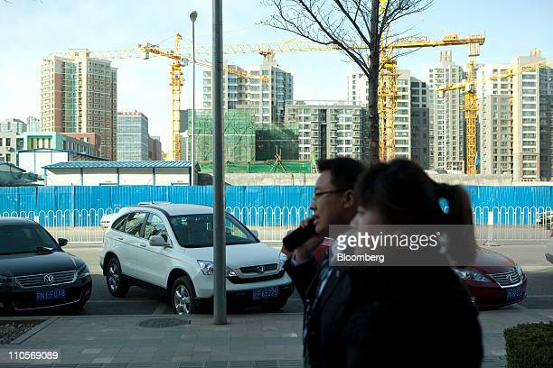 A man speaks on a mobile phone in Beijing China on Tuesday March 22 2011 China Telecom Corp the country's biggest fixedline carrier said it plans to...