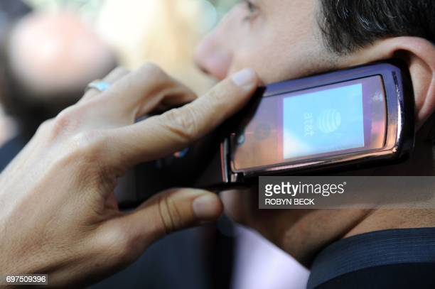 A man speaks on his cell phone in the Hollywood section of Los Angeles May 11 2010 AFP PHOTO / Robyn Beck / AFP PHOTO / ROBYN BECK
