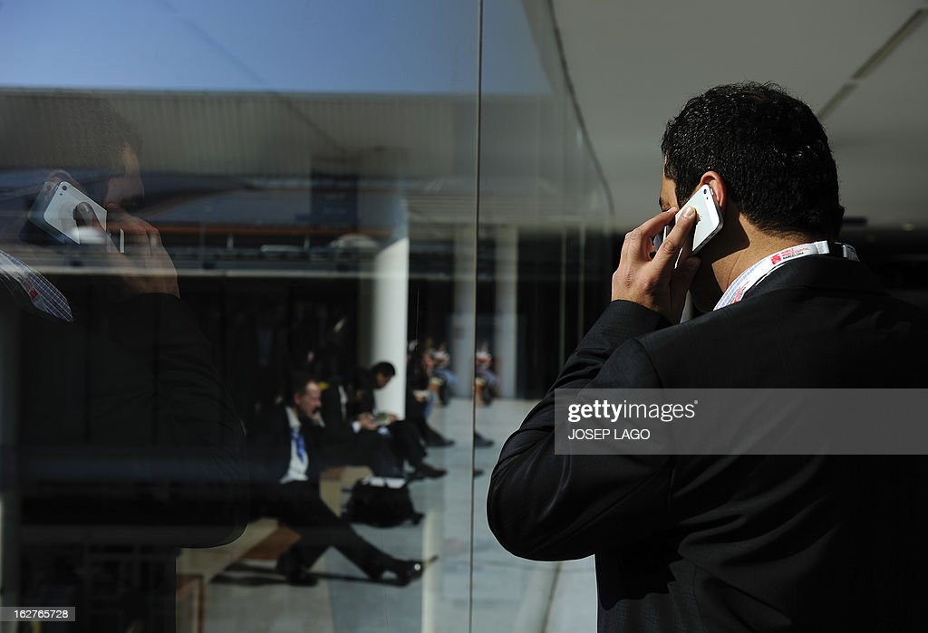 A man speaks on his mobile phone at the 2013 Mobile World Congress in Barcelona on February 26, 2013. The 2013 Mobile World Congress, the world's biggest mobile fair, is held from February 25 to 28 in Barcelona.