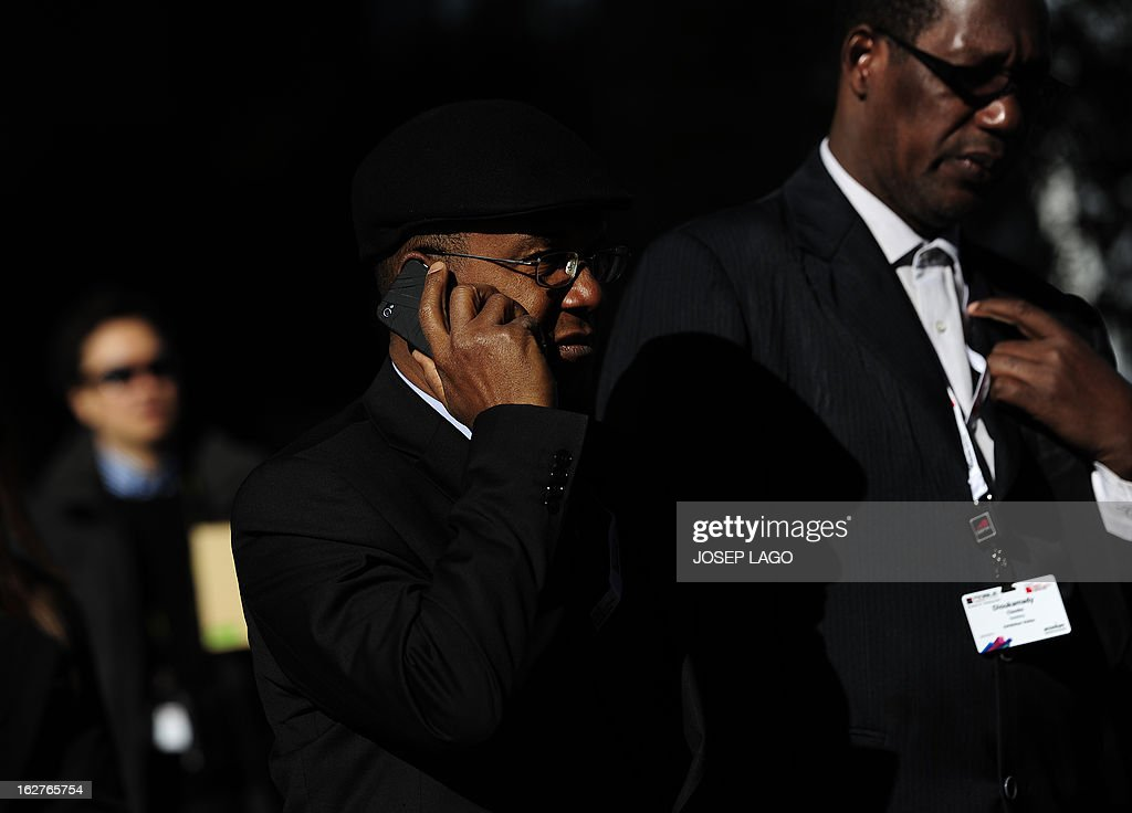 A man speaks on his mobile phone at the 2013 Mobile World Congress in Barcelona on February 26, 2013. The 2013 Mobile World Congress, the world's biggest mobile fair, is held from February 25 to 28 in Barcelona. AFP PHOTO / JOSEP LAGO