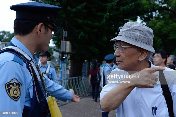 A man speaks to police as he protests outside the National Diet on July 16 2015 in Tokyo Japan The protest is against the security bill approved by...