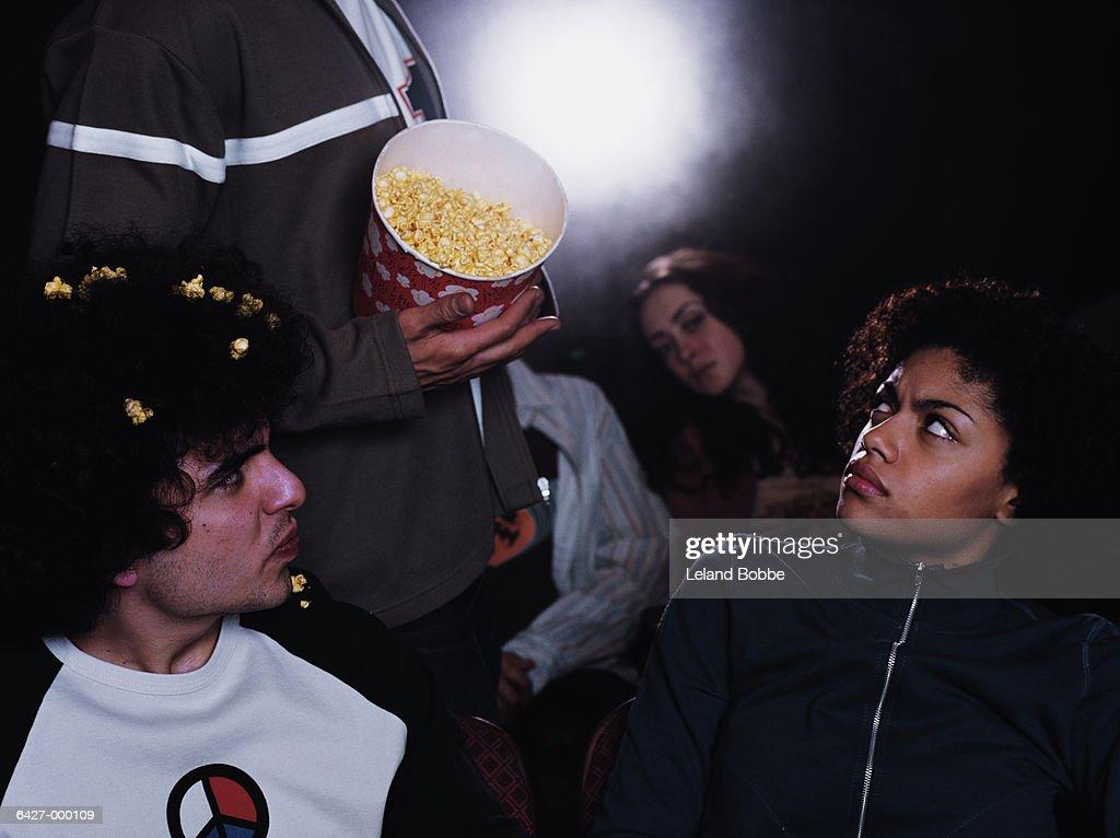 Man Spilling Popcorn in Movie : Stock-Foto