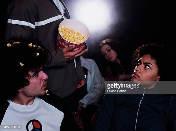 Man Spilling Popcorn in Movie