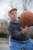 Man spinning basketball on his finger