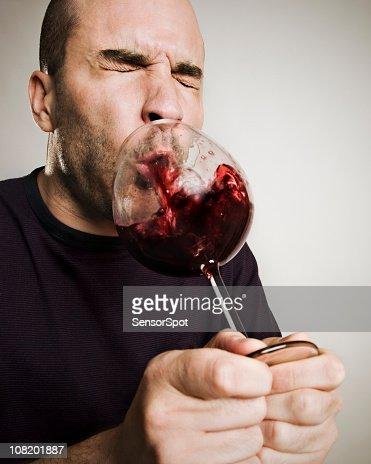 Man Spitting Wine Back into Glass