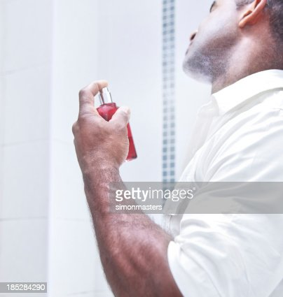 Man spraying aftershave