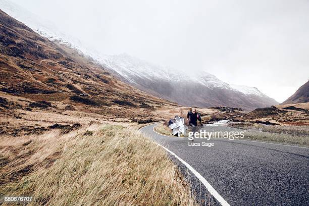 Man sprint training on a Scottish mountain road