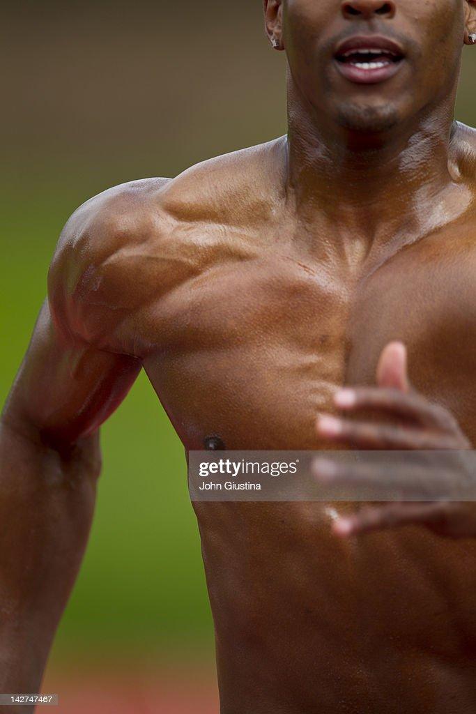 Man sprinting down track, close-up : Stock Photo