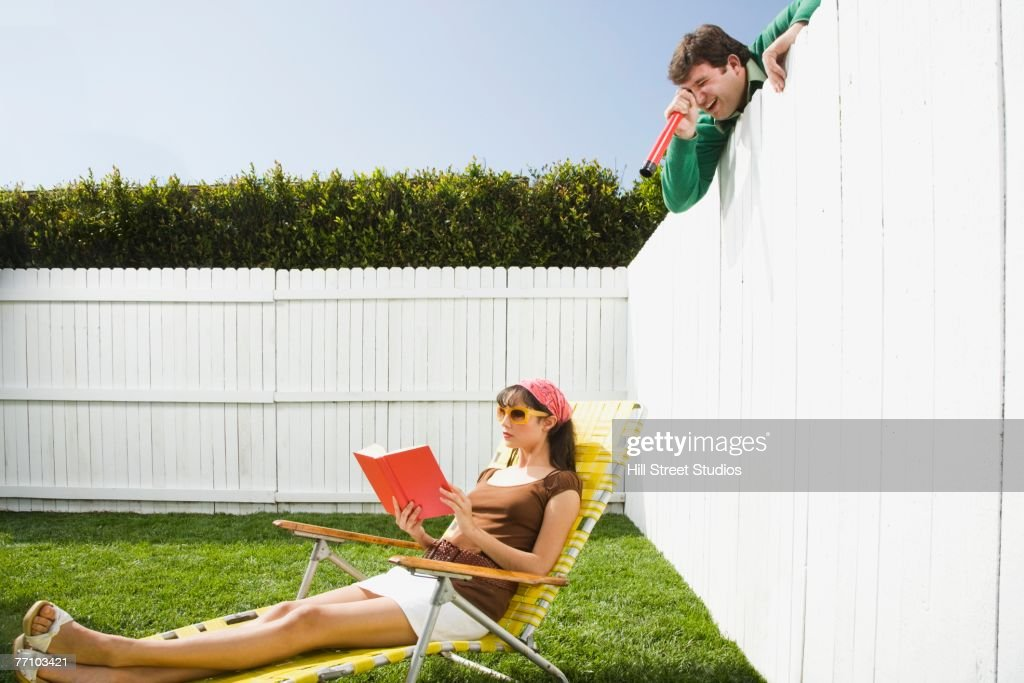 Man spying on women over fence
