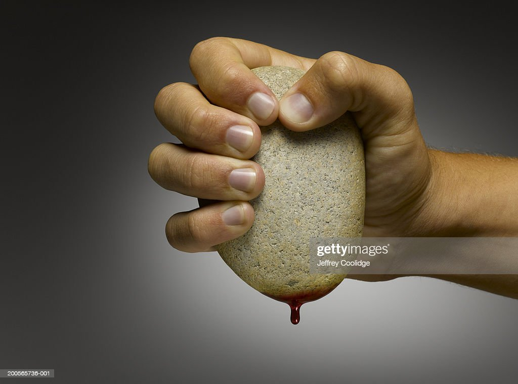 Man squeezing blood from stone