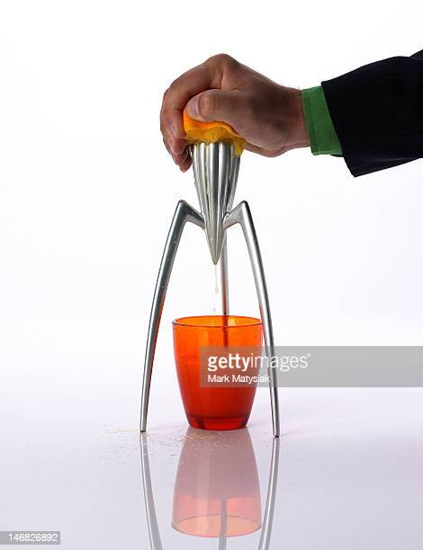Man squeezing orange juice with retro juicer