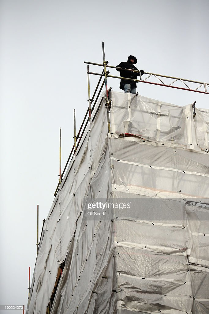A man stages a rooftop protest on top of a building covered with scaffolding on Fleet Street on January 28, 2013 in London, England. The protester has displayed a banner providing details of an alleged miscarriage of justice.