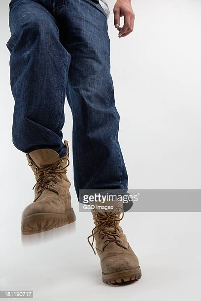 Man stamps with heavy work boot
