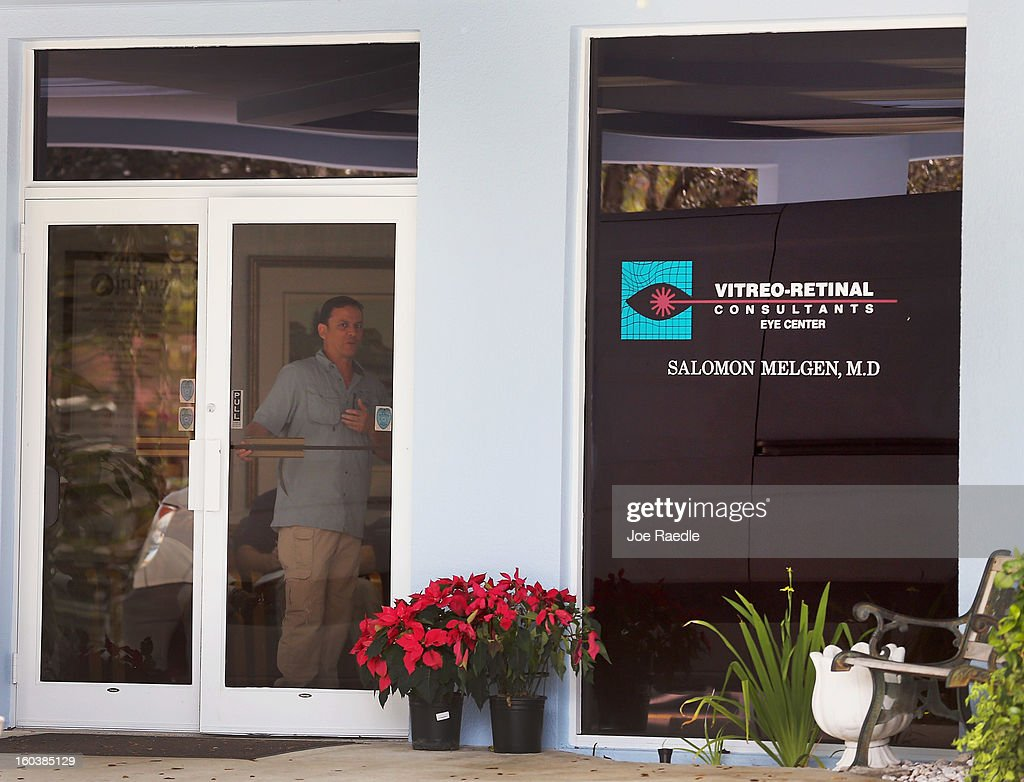 A man stand in the door as FBI agents and other law enforcement officials investigate at the medical-office complex of Dr. Salomon Melgen who has possible ties to U.S. Sen. Bob Menendez (D-NJ) on January 30, 2013 in West Palm Beach, Florida. The agents arrived last night at the medical-office complex and started taking away potential evidence in several vans.