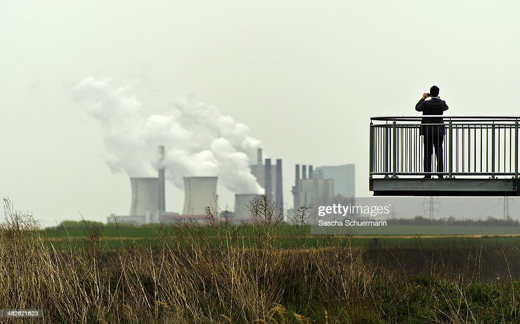 A man stand on a platform at the brown coal open cast mine Garzweiler on April 3, 2014 near Immerath, Germany. The small town Immerath and surrounding towns belonging to Erkelenz will be wiped off the map to allow energy giant RWE enlarge the huge open pit mine Garzweiler. A recent European Union study rated the Neurath power plant as the biggest emitter of CO2 in Germany, with 33.3 million tons in 2013, making it the second biggest in Europe. Owned by energy conglomerate RWE, the Neurath plant began operation in the 1970s and expanded with added blocks in 2012. It currently produces 4,400 megawatts of electricity annually, making it also the second biggest electricity producer in Europe.