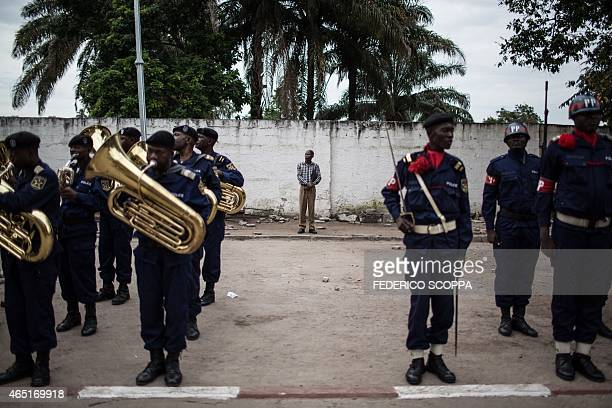 A man stand outside the Provincial Police HQ looking at the Guard of honor before the parade for the official presentation of three new humanlike...