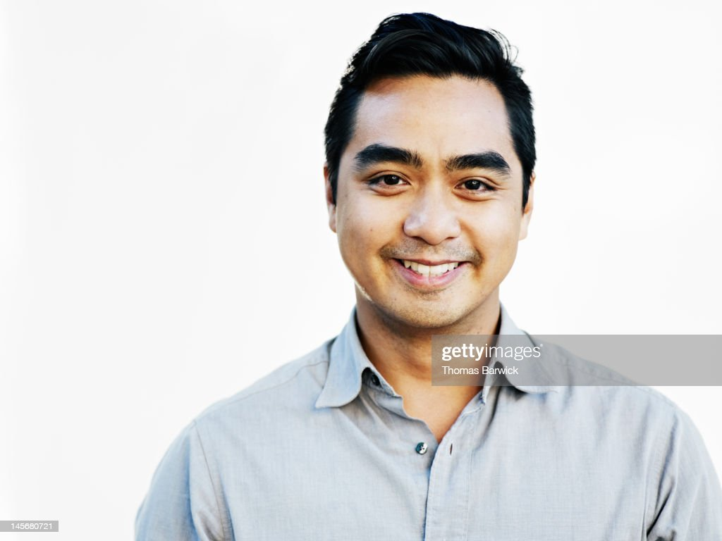 Man standing against white background smiling : Stock Photo