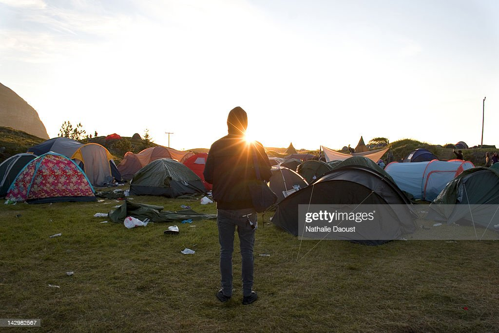 Man standing alone on camping ground : Stock Photo