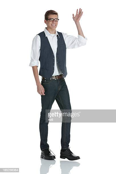 Man standing and waving hand