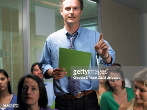 Man standing, asking a question