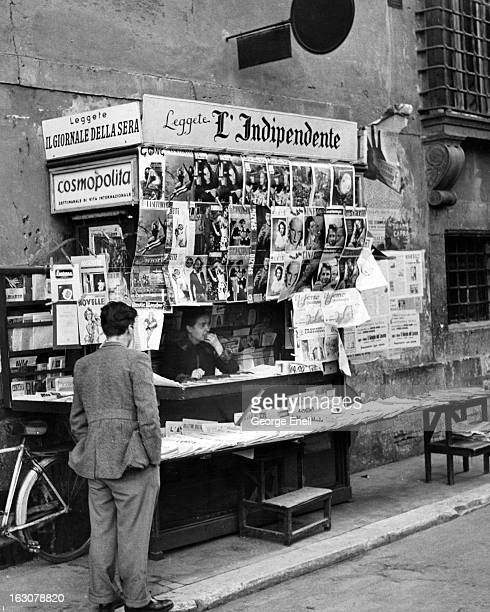 A man standing at a news stand in Rome Italy 1955