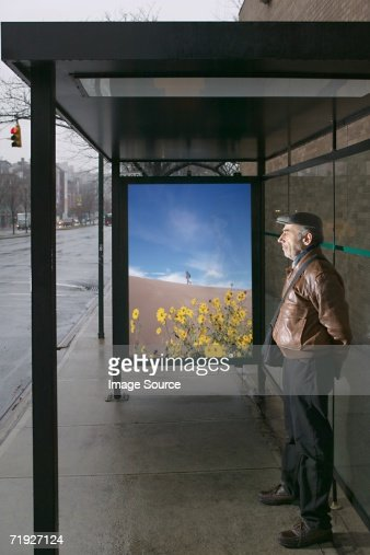 Man standing at bus shelter