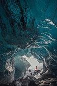 Man standing at ice cave entrance, Vatnajokull Glacier, Vatnajokull National Park, Iceland