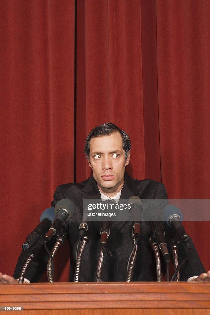 Man standing at podium : Stock Photo