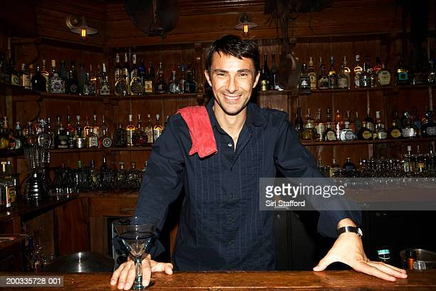 Man standing behind bar, portrait