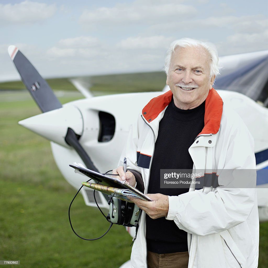 Man standing by a small airplane : Stock Photo