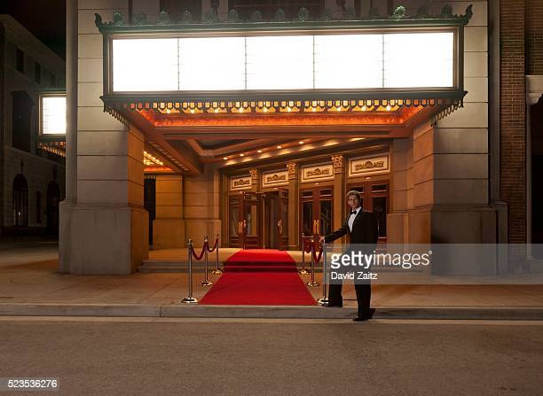 Man standing by the red carpet
