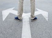 Man standing hesitating to make decision