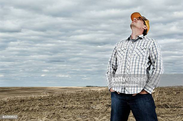 Man Standing in a Dry Field.
