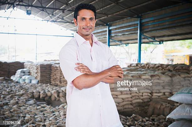 Man standing in a warehouse, Anaj Mandi, Sohna, Gurgaon, Haryana, India